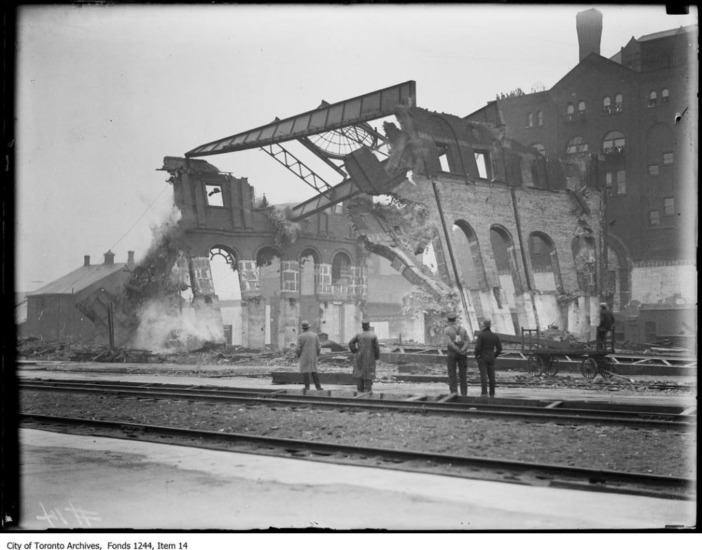 Men viewing the demolition of fire remains at site of future Union Station. - [ca. 1907]